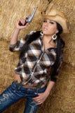 Cowgirl con el arma Foto de archivo libre de regalías