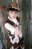 Cowgirl in country outfit, old wooden background Stock Photo