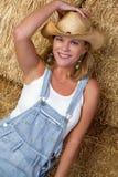 Cowgirl de sorriso Imagem de Stock Royalty Free