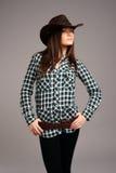Cowgirl del rodeo in un cappello di cowboy Immagini Stock Libere da Diritti