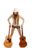 Cowgirl di Sesy in cappello di cowboy con la chitarra acustica Fotografie Stock