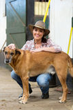 Cowgirl dog farm house. Cheerful cowgirl and her dog inside farm house Royalty Free Stock Photography