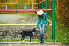 Cowgirl with a dog Royalty Free Stock Image