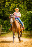 Cowgirl doing horse riding on countryside meadow Royalty Free Stock Photos