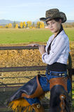 Cowgirl on Fence Stock Photography