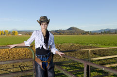 Cowgirl on Fence Royalty Free Stock Photography