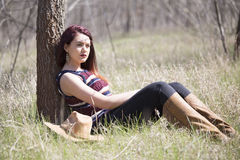 Cowgirl in forest shooting. Cowgirl in wood , relax and shooting Stock Photo