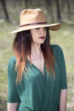 Cowgirl in forest shooting. Cowgirl in wood , relax and shooting Royalty Free Stock Images