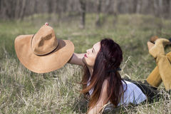 Cowgirl in forest shooting. Cowgirl in wood , relax and shooting Stock Image