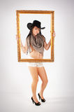 Cowgirl and frame Stock Image