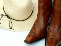 Cowgirl gear. Straw cowboy hat and boots Stock Photo