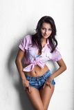Cowgirl girl in shorts Royalty Free Stock Image