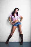 Cowgirl girl in shorts Stock Photos