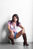 Cowgirl girl in shorts Stock Image