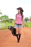 Cowgirl going home Royalty Free Stock Photos