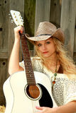 Cowgirl and Guitar Royalty Free Stock Images