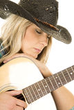 Cowgirl with guitar in blue shirt close eyes closed Royalty Free Stock Photos