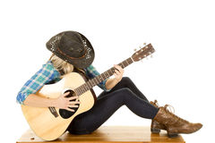 Cowgirl with guitar in blue shirt sit knees Stock Photo