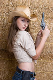 Cowgirl With Gun. Young country cowgirl with gun royalty free stock photos