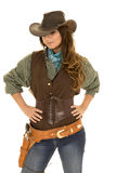 Cowgirl with gun and holster hands on hips Royalty Free Stock Images