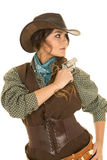 Cowgirl with gun and holster look side Stock Image
