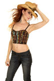 Cowgirl halter top stand hair blowing hold hat Stock Images