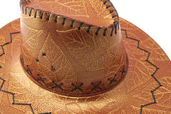 Cowgirl hat. Brown cowgirl hat with flower and leaves tracery Stock Photography
