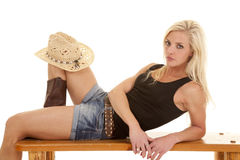 Cowgirl hat knee lay look Royalty Free Stock Photos