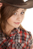 Cowgirl hat plaid shirt close looking Stock Photography
