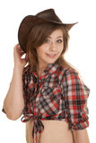 Cowgirl hat plaid shirt hand behind hat Royalty Free Stock Photography