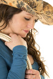 Cowgirl with hat and rope over shoulder close look down Stock Image