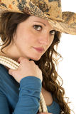 Cowgirl with hat and rope over shoulder close looking Stock Photo