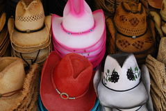 Cowgirl hats. Stacks of cowgirl hats forsale at the fair Royalty Free Stock Photo