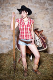 Cowgirl with hay fork Stock Images