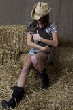 Cowgirl and her cat Stock Photo