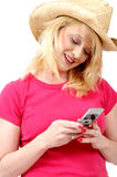 Cowgirl on her Cell Phone Stock Photos