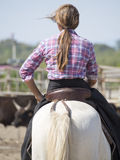 Cowgirl on her horse Stock Photo