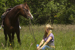 Cowgirl with her horse Stock Photography
