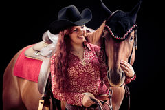Cowgirl With Her Horse. Studio shot on black background Stock Image