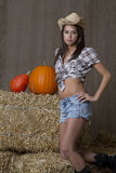 A cowgirl and her squashes Stock Images