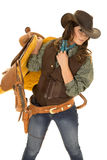 Cowgirl hold saddle on shoulder Royalty Free Stock Photos