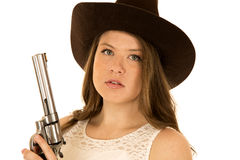 Cowgirl holding a big revolver with a serious expression Royalty Free Stock Photos