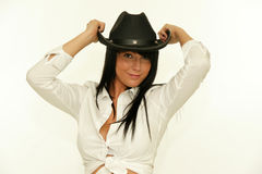 Cowgirl holding black western hat Stock Photo