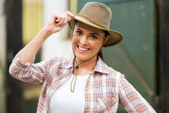 Cowgirl holding hat Stock Photo