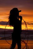 Cowgirl Holding Rope Stock Photography