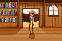 A cowgirl holding a rope beside the three wooden shelves with bo Stock Photos