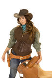 Cowgirl Holding Saddle Hand By Gun Royalty Free Stock Image