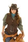 Cowgirl holding saddle hand on gun Stock Photos