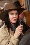 Cowgirl Holding a Shot in a Bar Stock Image
