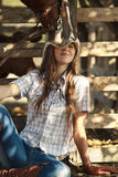 Cowgirl with horse. Young cowgirl with horse  licking all over her hat Royalty Free Stock Image
